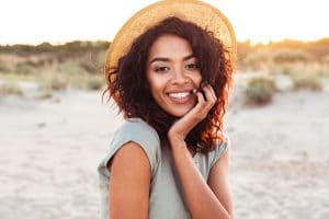 Portrait of gorgeous african american woman 20s in summer straw