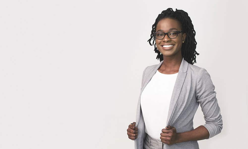Successful Entrepreneurship. Happy Afro Business Girl Smiling At Camera Over White Background